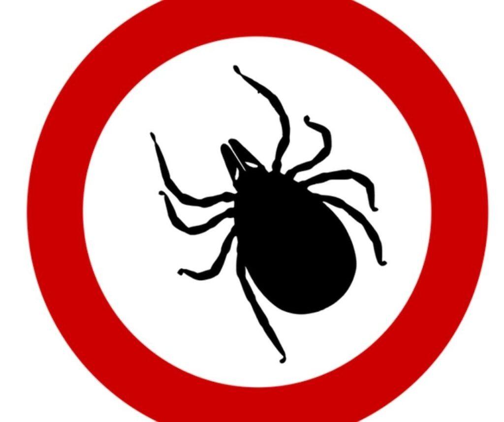 znak opasnosti za krpelj