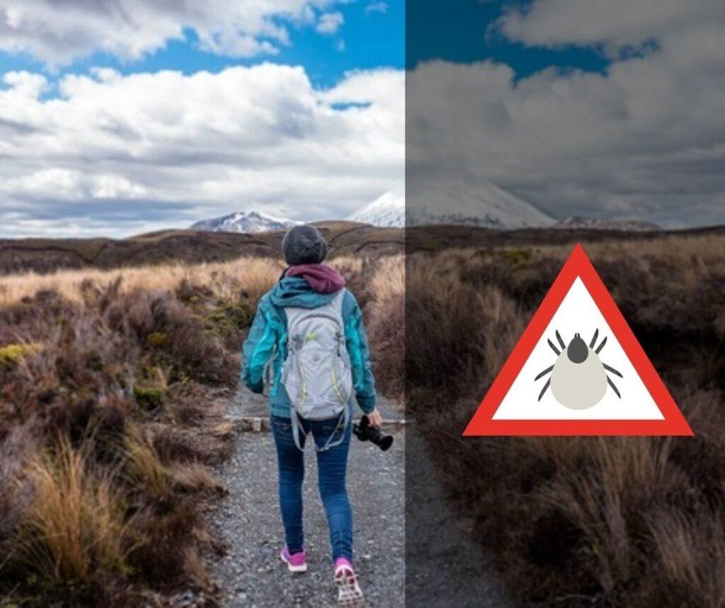 Žena planinari uz znak opasnosti od krpelja